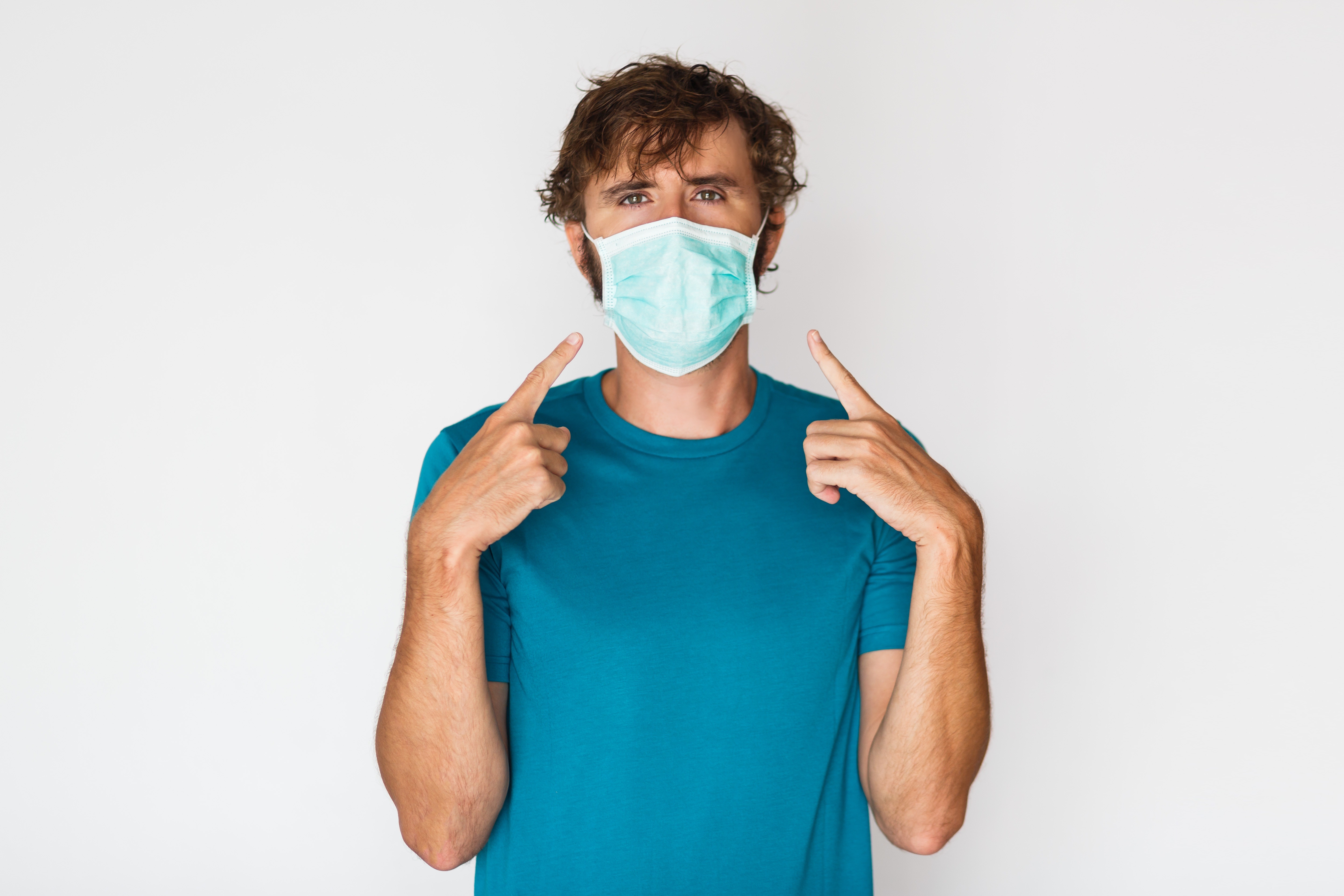 european-man-in-protective-mask-pointing-to-himself